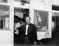 Str. Sidney - Man standing outside Purser/Clerk's Office