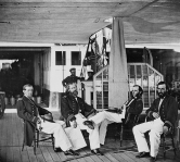 Seated officers on the USS Hunchback, a converted side-wheel civilian ferry.