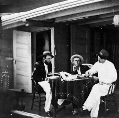 Acting Assistant Paymaster Henry Cushing (in white on right) on board the USS Hunchback