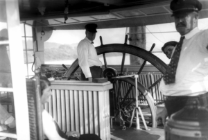 Capt. James (Big Jim) Brusbee and Capt. Milt Campbell in the pilothouse of the Str. Cincinnati