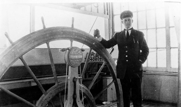 Pilot Edgar Brookhart in the pilothouse of the Queen City, 1910
