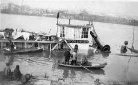 Men inspect the wreck of the Steamboat Monitor - 1 of 2