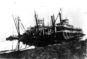 Wreck of the steamboat Tennessee, Missouri River, at Little Blue Island, Mo. Snagboat Missouri standing by 1908