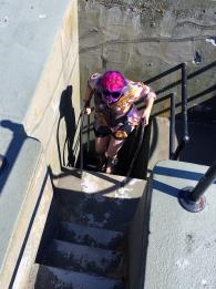 Kari-Lise climbing ladders.
