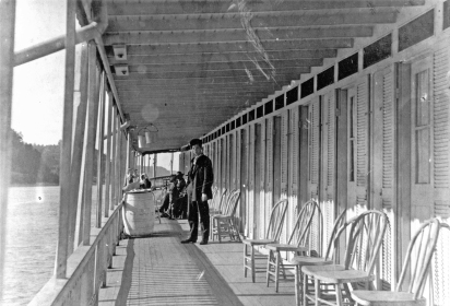 Crew member and passengers on promenade of the Str. Dubuque