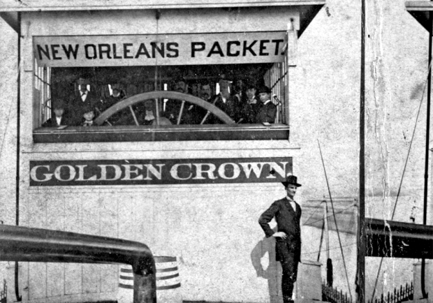 A passenger standing outside of the Str. Golden Crown's pilothouse