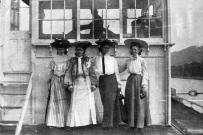 Four women standing in front of the Str. Ruth No. 2's pilothouse
