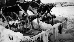 An ice and snow covered paddle wheel