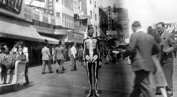 A man in a skeleton costume.