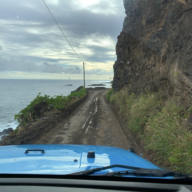 View through the windshield of the road past Hana